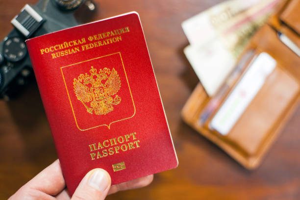 Russian travel passport in hand with wallet and photo camera in the picture id1088224826?b=1&k=6&m=1088224826&s=612x612&w=0&h=rpqnksskuomtltjlzp7wv45o4obwo1z3ev2xslraqa8=