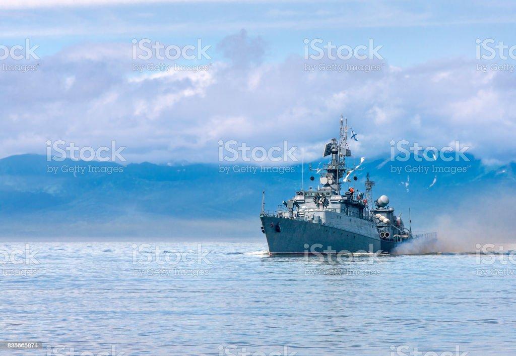 Russian warship going along the coast stock photo