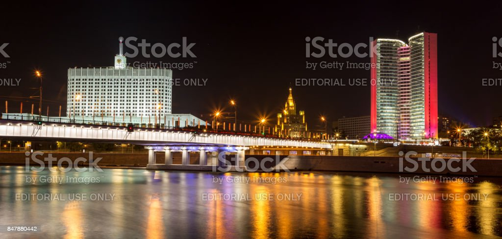 Russian White House (House of the Government of the Russian Federation) and former House of the Council for Mutual Economic Assistance (Comecon) in Moscow at night. Colorful illumination and reflections in the river stock photo