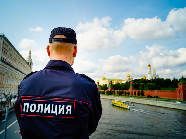 Russian young policeman looking at Kremlin from the bridge stock photo