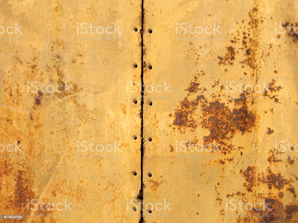 Rust on two old sheets of metal texture connected by bolts stock photo