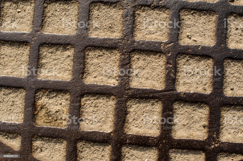 Rust steel grate with the sand inside the square stock photo