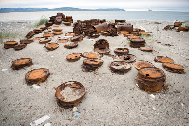 Rusted barrels on the shore, Chukotka, Russia stock photo