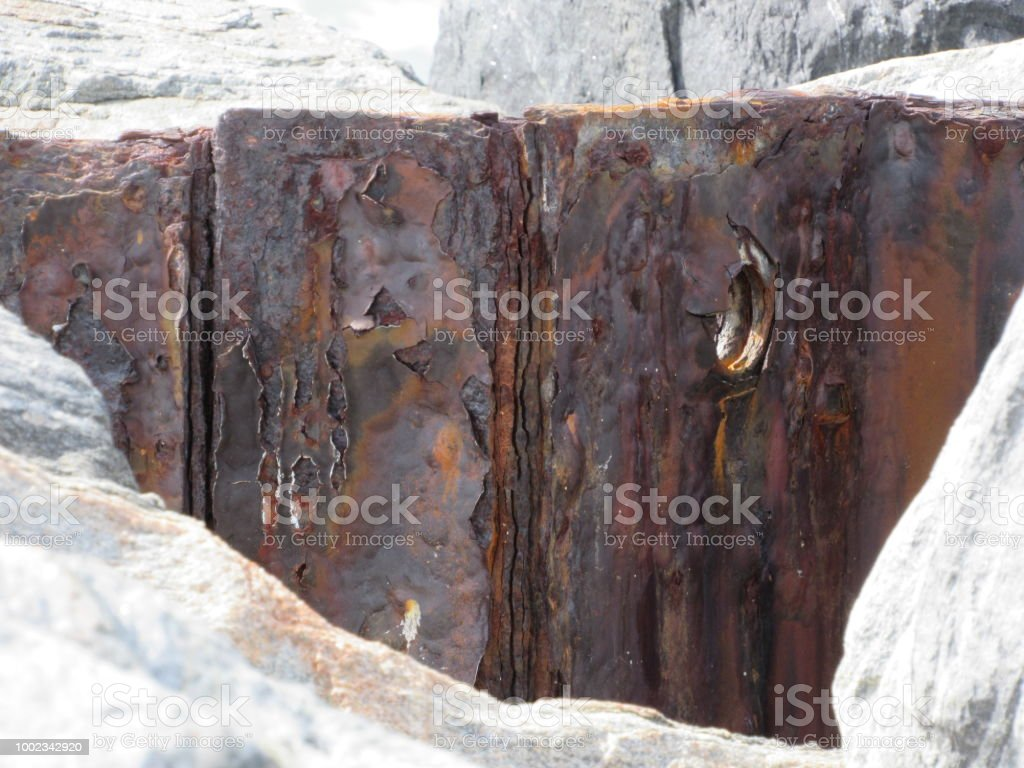 Rusted barrier on Jetty stock photo
