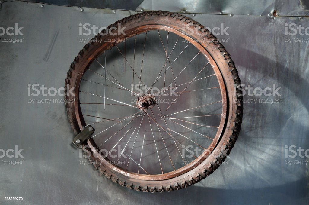 Rusted bicycle wheel stock photo