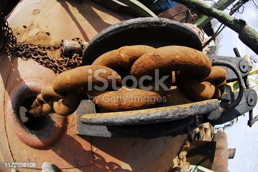 Close up of a rusty anchor chain. River port
