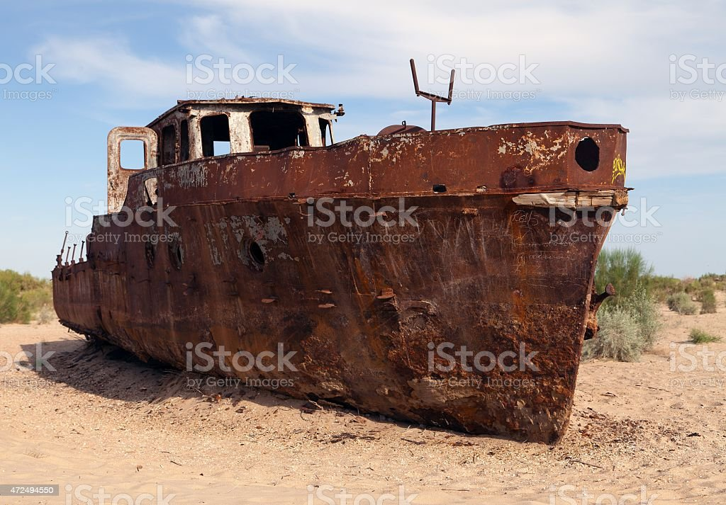 Rusted boat in desert around Moynaq-Aral sea stock photo