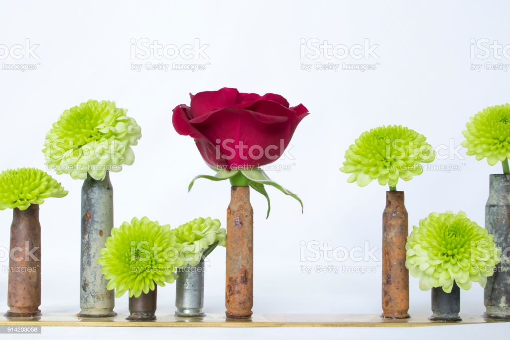 Rusted Bullet Casings Or Shells As Bud Vases Holding Flowers And