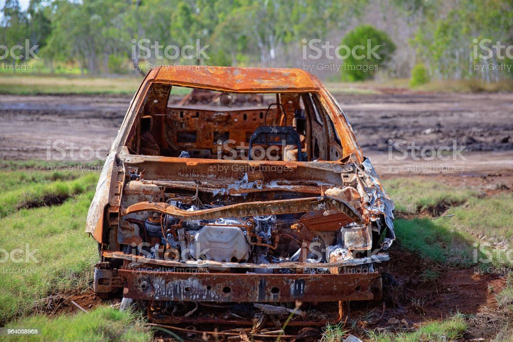 A Rusted Car Wrecked And Abandoned Amongst The Mangroves - Royalty-free Abandoned Stock Photo