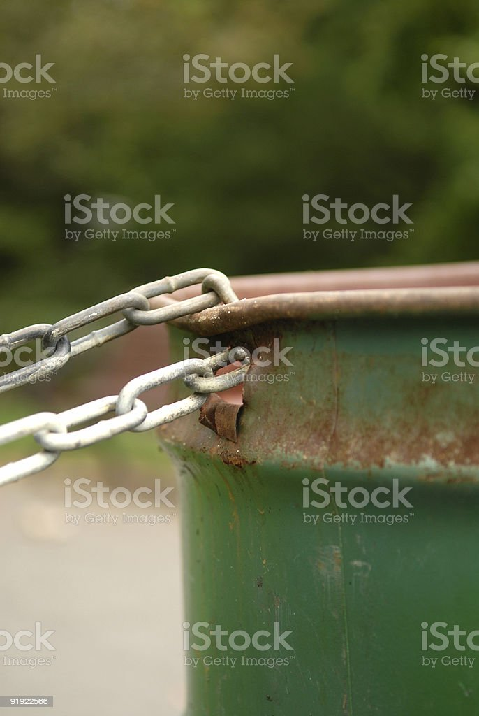 Rusted Chained Metal Garbage Can in the Park royalty-free stock photo