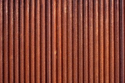 Corrugated metal fencing