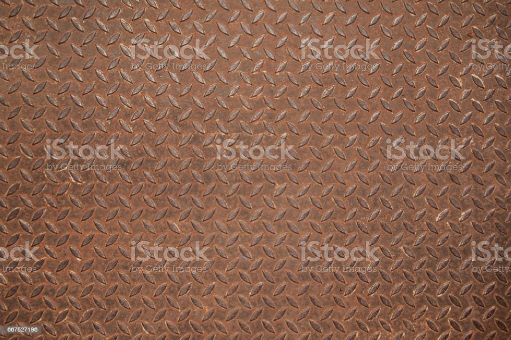 Rusted diamond steel plate useful as a background foto stock royalty-free