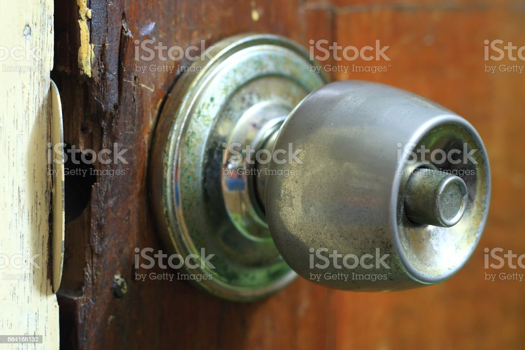 rusted door knob on old wooden door royalty-free stock photo
