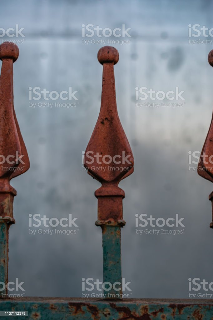 rusted fence top metal stock photo