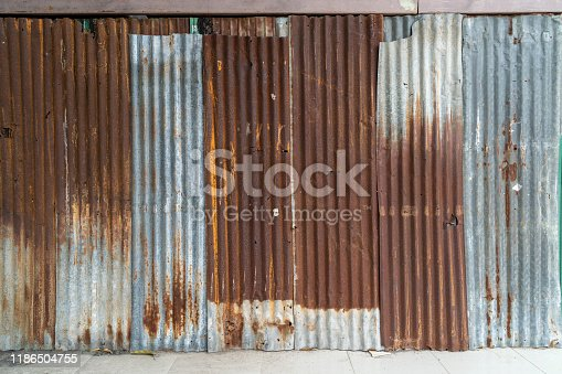 638964834istockphoto Rusted galvanized iron plate, red stain on old metal sheet wall texture. 1186504755