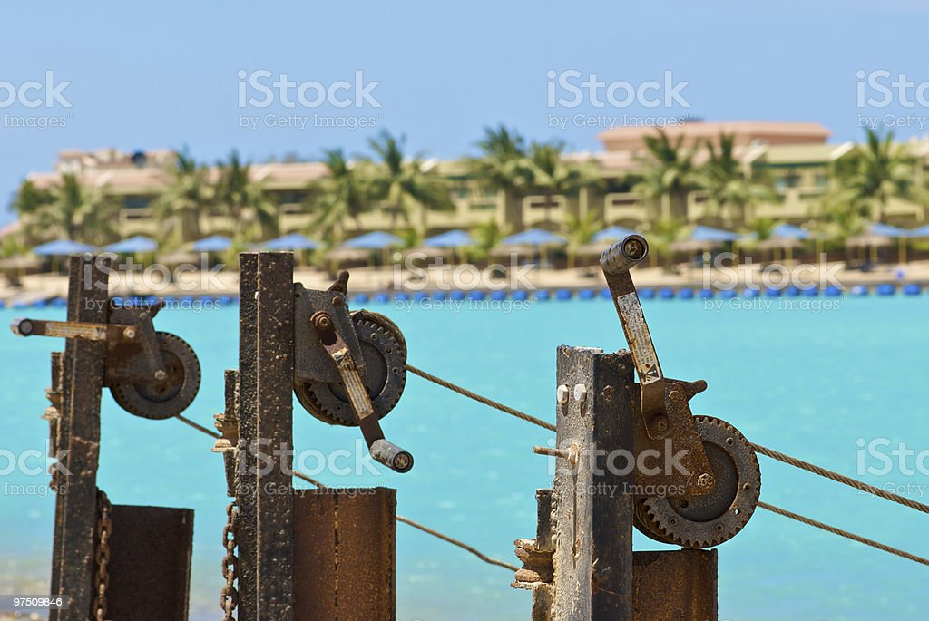 Rusted gears at the beach royalty-free stock photo