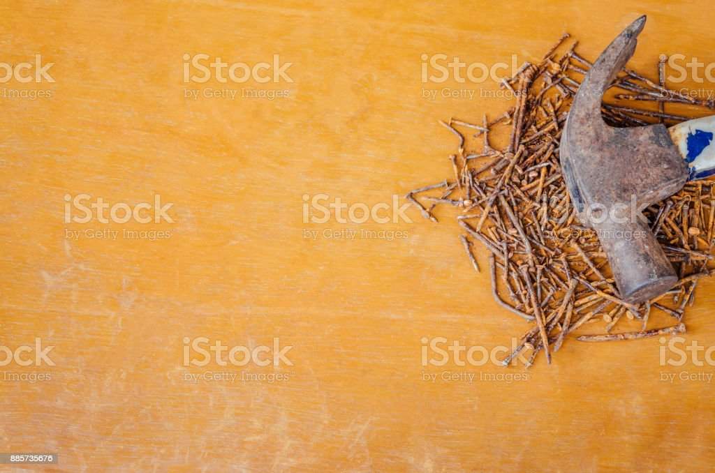 Rusted hammer head and nails stock photo