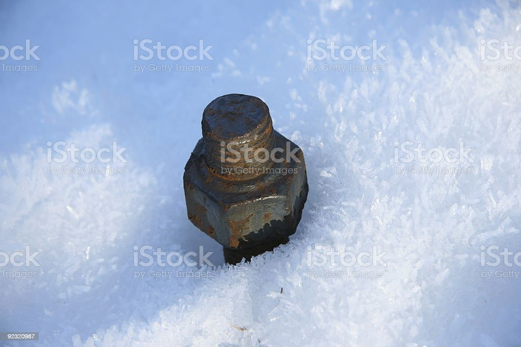 Rusted Hex Nut in Snow stock photo