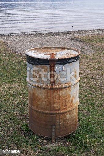 an abandoned metal barrel
