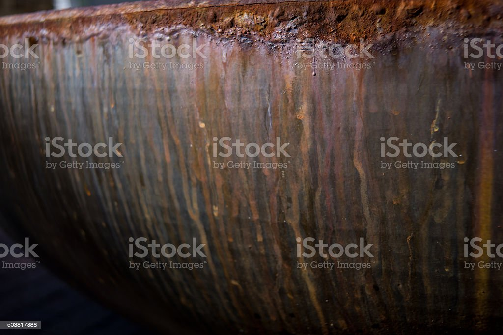 rusted metal with drip residue horizontal stock photo