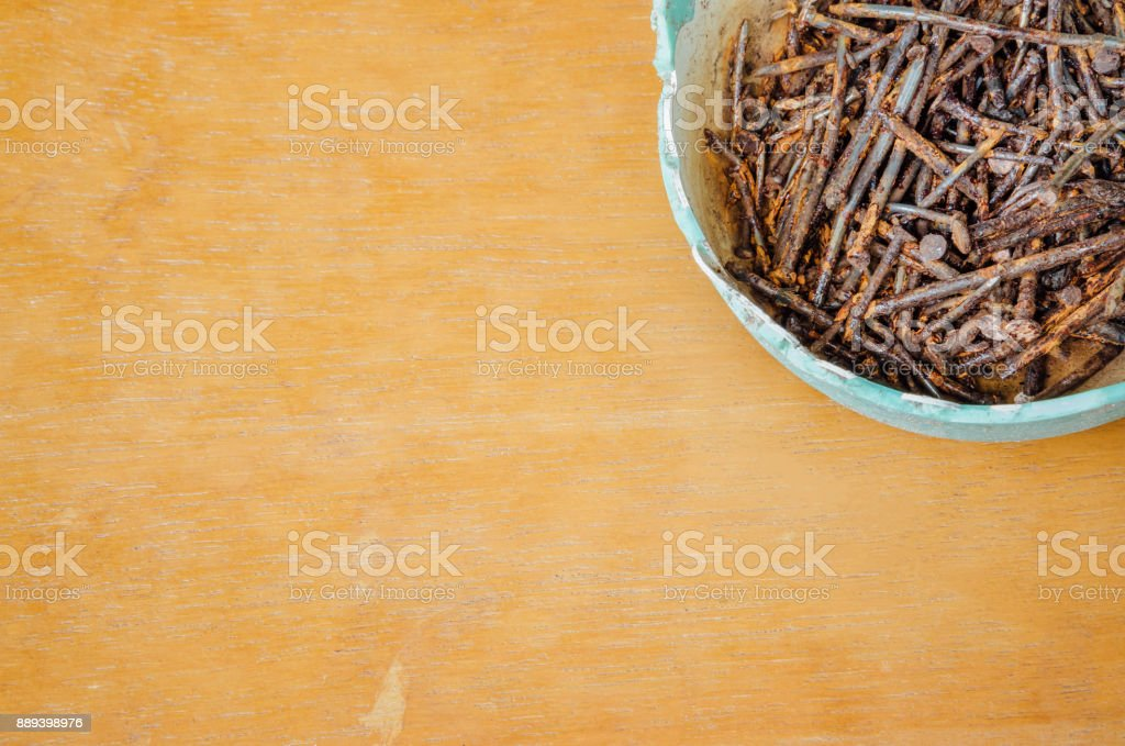 Rusted nails in old bowl stock photo