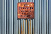 Rusted 'No Trespassing' sign