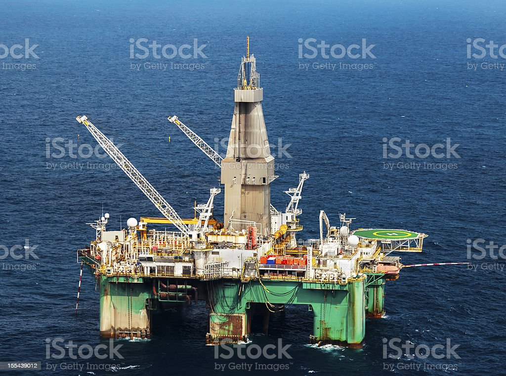 Aerial photo of a large offshore oil rig off the coast of Africa.