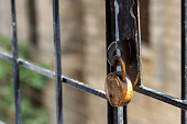 Rusted old lock on a iron grill for safety
