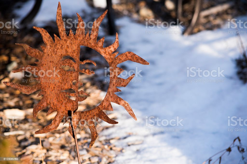 Rusted Sun yard decoration royalty-free stock photo