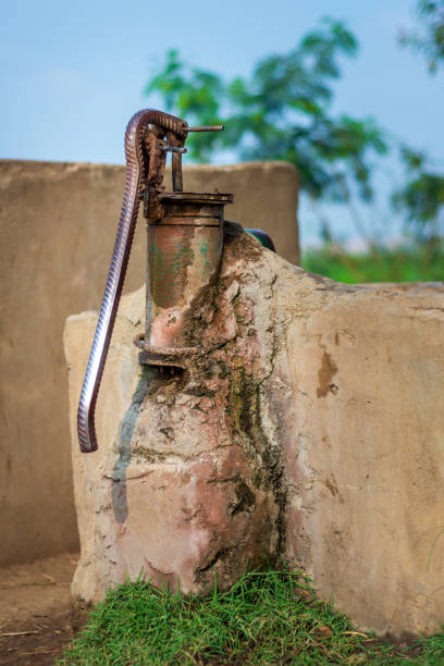 Rusted traditional old hand operated water pump at Egyptian rural village stock photo