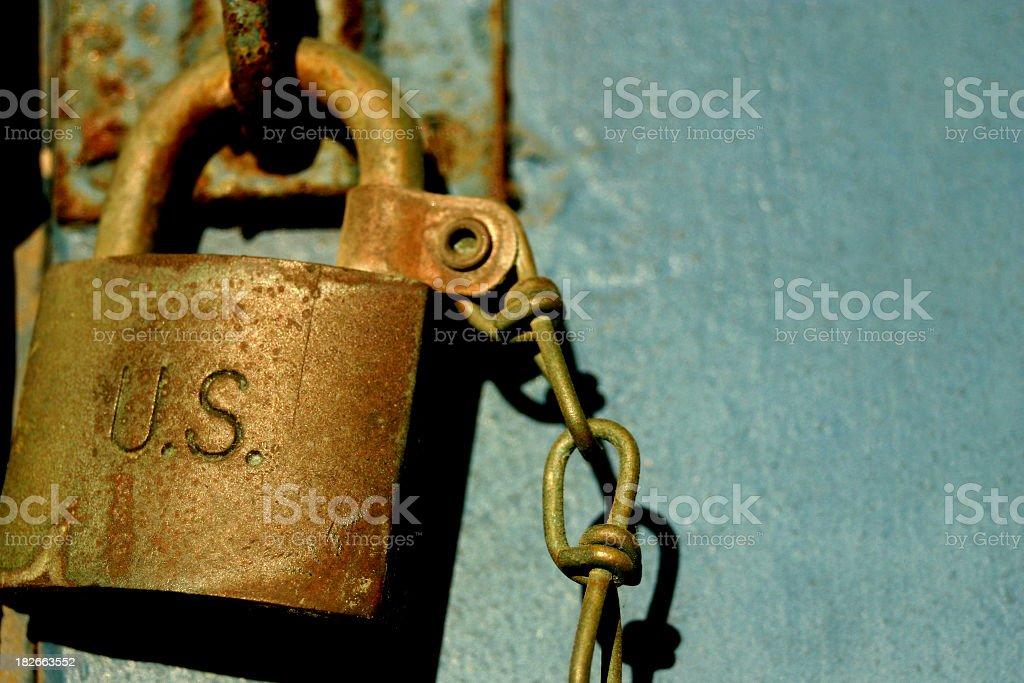 Rusted 'US' padlock royalty-free stock photo