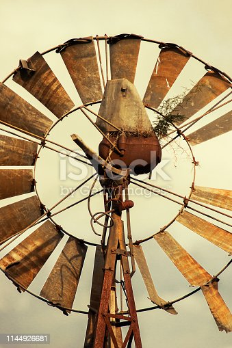 Rusted windmill in the countryside of Queensland, Australia.