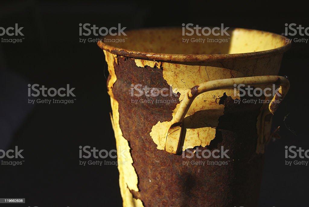 Rusted yellow bucket royalty-free stock photo