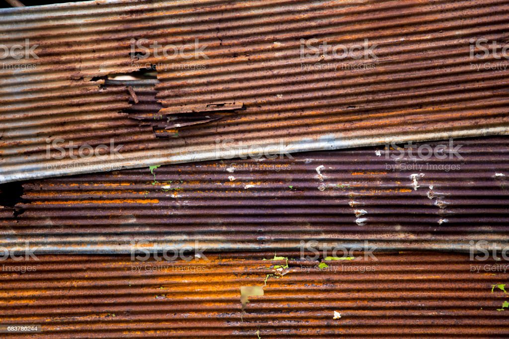 Rusted zinc steel sheet, there is not rusted all the sheet some area still no rusted created it created pattern. stock photo