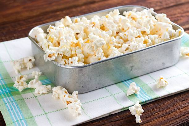 Rustic aluminum pan with popcorn stock photo