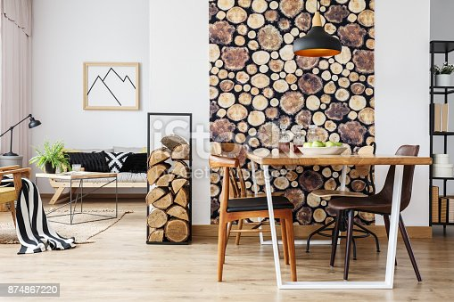 istock Rustic apartment with table and sofa 874867220
