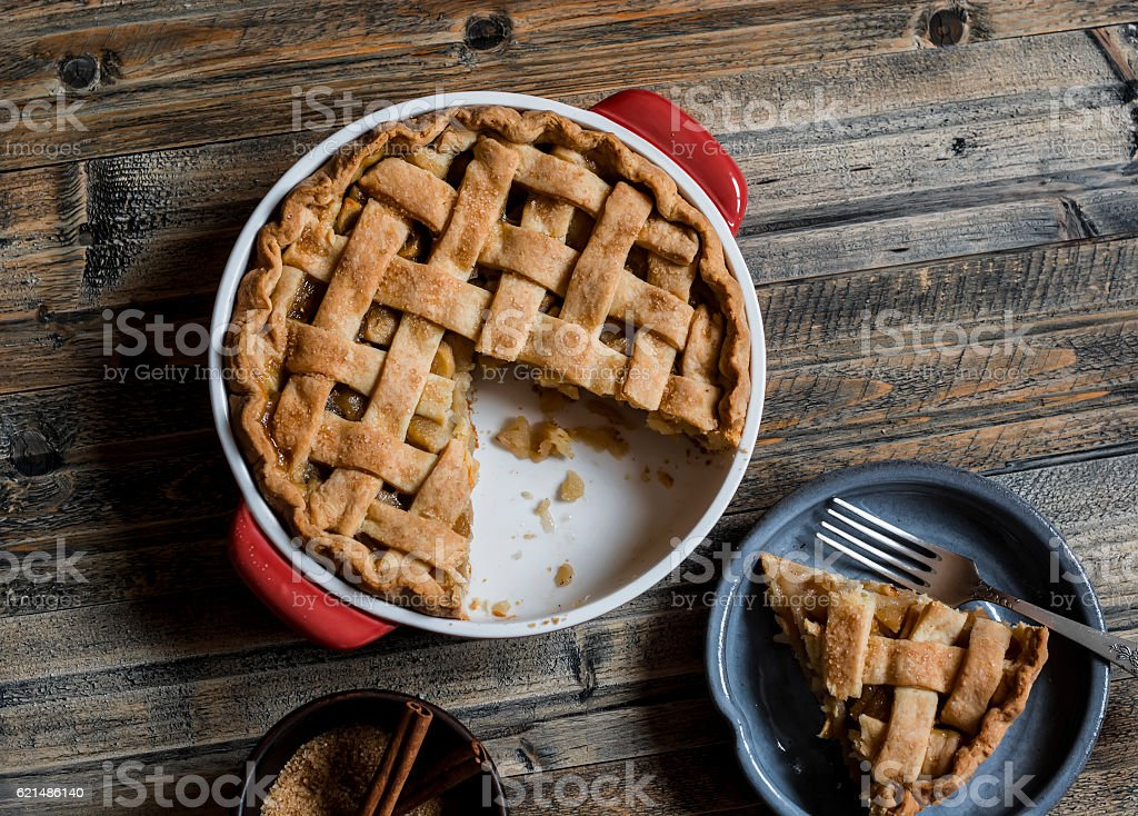 Rustic apple pie on wooden table, top view. stock photo