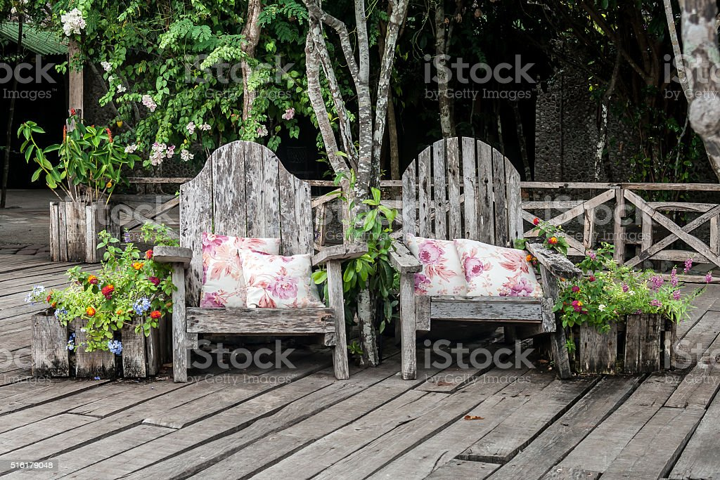 Rustic armhairs with pillows stock photo