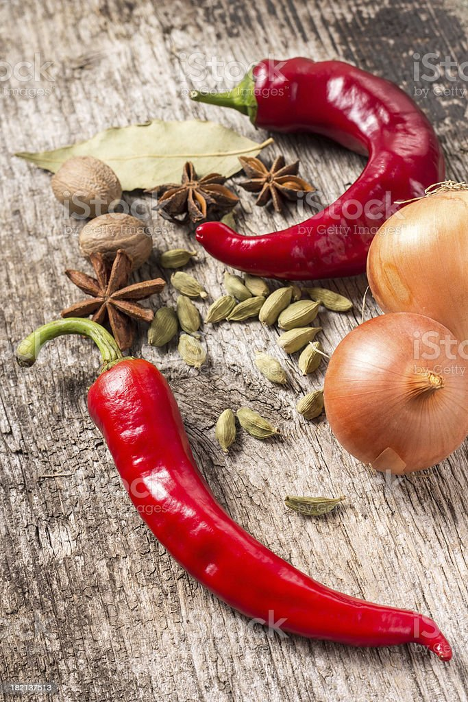 Rustic background of Spices on wooden plank royalty-free stock photo