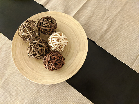 Rustic background with vine balls on wooden plate