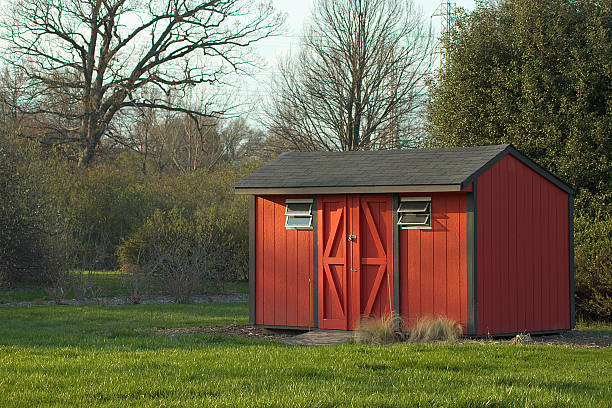 Rustic backyard shed made of red wood panels shed shed stock pictures, royalty-free photos & images