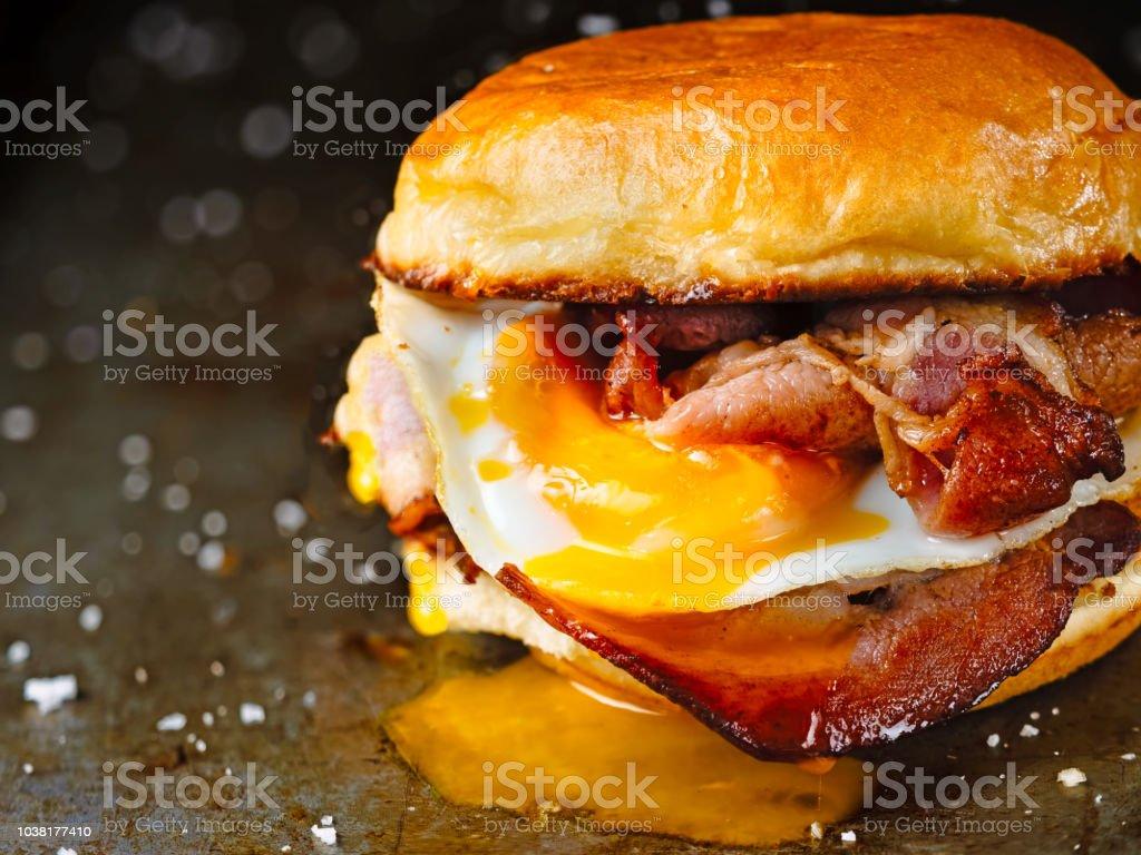 rustic bacon egg breakfast sandwich bun stock photo