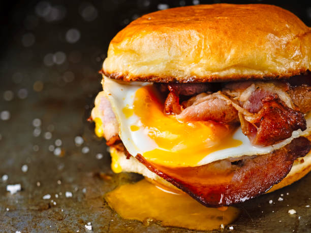 rustic bacon egg breakfast sandwich bun stock photo