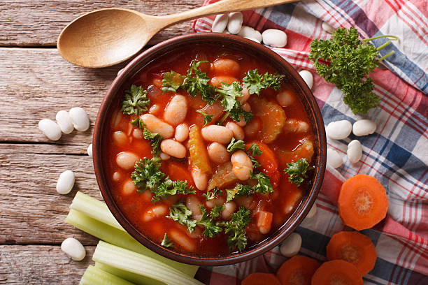 rustic bean soup with ingredients close up. horizontal top view - minestrone foto e immagini stock