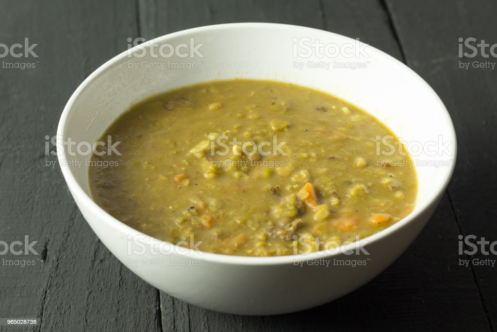 Rustic beef, vegetable and barley soup on black table royalty-free stock photo