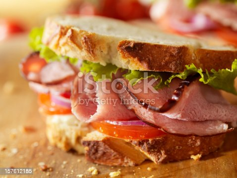 Rustic Black Forest Ham Sandwich with Lettuce, Tomato, Red Onions and Mayo -Photographed on Hasselblad H3D2-39mb Camera