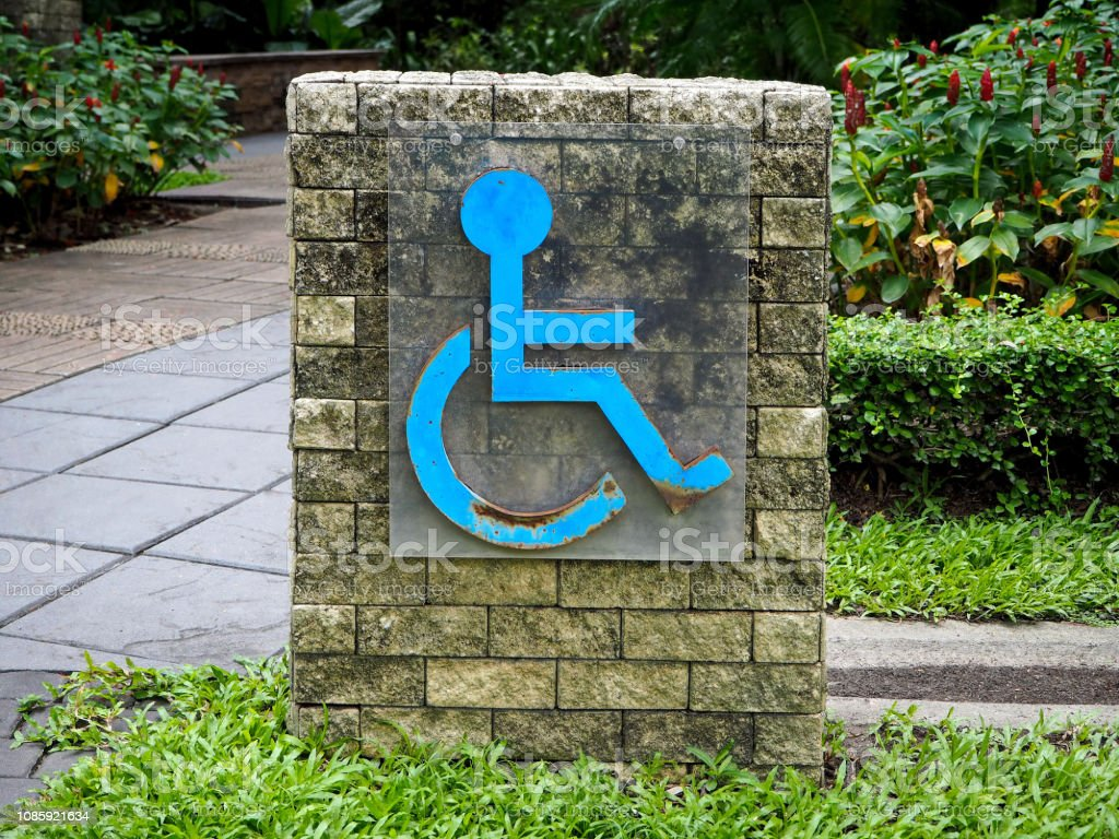 Rustic Blue Metal Handicap Sign stock photo