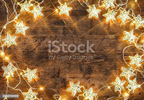 istock Rustic board with garland of stars 636658568