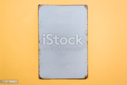 924754302istockphoto rustic board with white color on yellow background 1137785822
