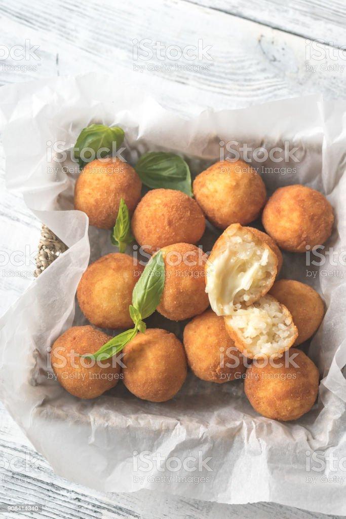 Rustic bowl of arancini stock photo